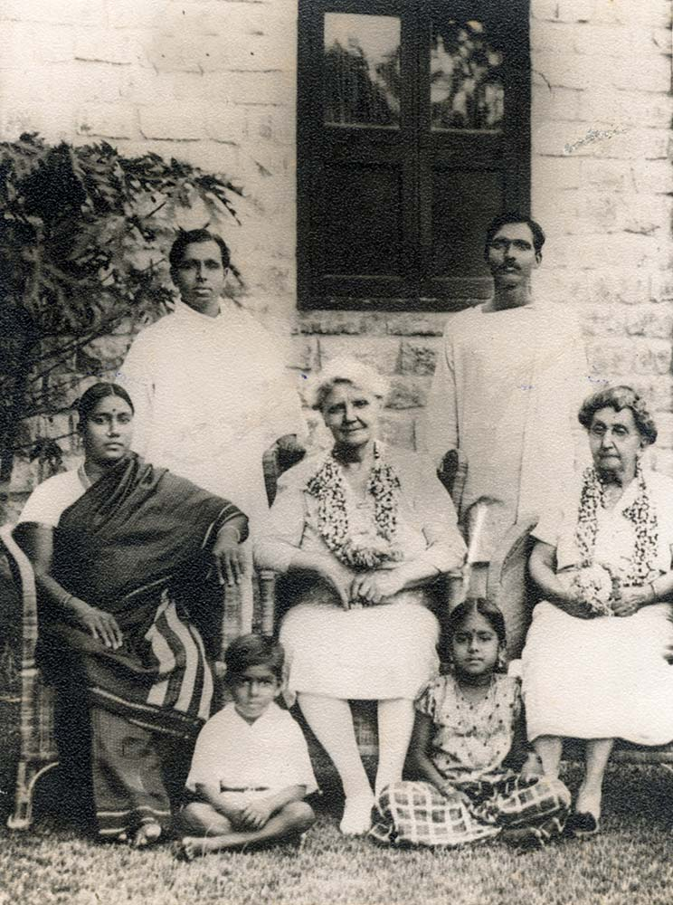 Kalki (standing left) and wife Rukmini (seated left) with Dr. Ida Sophia Scudder (seated center), founder of the Vellore Medical College, who treated Rukmini Krishnamurthy. Seated on the ground are children Rajendran and Anandhi